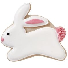 Bounding Bunny Cookie - Our cookie cottontail arrives just in time for your Easter egg-stravaganza! Made with the Wilton Easter Cutter Set and satin-smooth Color Flow Icing, he's the perfect Easter Basket treat.