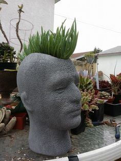 Styrofoam head with the top cut out. Painted Grey with acrylic.  Made by Michelle Lewis