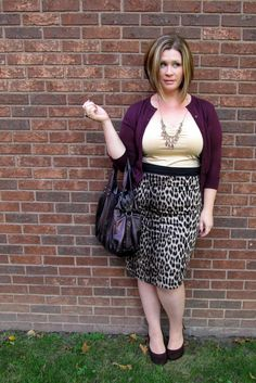 .@shessica17 of Surely Sonsy looks amazing for fall in her wine colored cardigan and animal print pencil skirt.