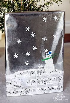 This awesome Christmas paper craft is a unique way to give Christmas cards this season! Use sheet music in your Christmas crafts!