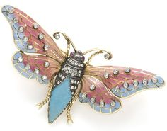 A plique-à-jour enamel, ruby and diamond moth brooch mounted in eighteen karat gold and silver; length: 3 1/4in.