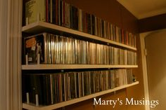 Great idea for CD storage! - Marty's Musings just painted 1″ x 6″ pine boards supported with L-brackets