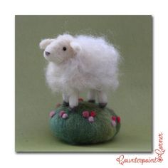 Needle felted sheep with a curly wool coat