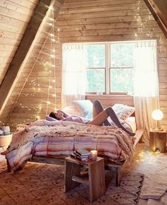 Cozy attic bedroom | shop the look: duvet cover - pillowcases - nightstand - blanket - wooly pillow - string lights - rug - wooden table - lamp - white cord string lights Follow Gravity Home: Blog - Instagram - Pinterest - Facebook - Shop