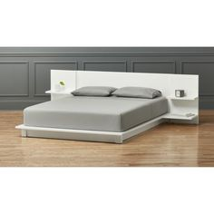 Hi-gloss white lacquer platform scales to new lo-heights integrating headboard nightstands that cantilever two stepped shelves each—one wide for books, one narrow with discreet cord cutouts for clock/light/dock. Bedroom Furniture, Furniture Design, Bedroom Decor, Blue Gray Bedroom, King Storage Bed, Bedding Storage, Bedding Sets, Simple Bed, Bed Reviews