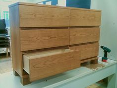 """Cherrywood drawer, walnut gap-covers and """"legs""""."""