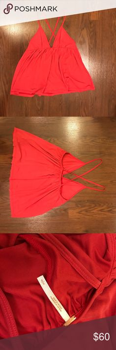 Free people babydoll top Hard to tell but this is burnt orange not pink. But this top is super soft and in great condition, never worn!! Free People Tops Tank Tops