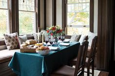 Corner banquette with lots of pillows (but more casual and welcoming than formal)