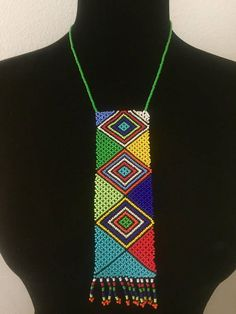 """Multicolored beaded necklace called """"Ulimi"""" (a Zulu word for a tounge) It can be worn by men and women. Handcrafted with seed beads using intricate Zulu beading techniques. Hand beaded by Zulu women from Durban, South Africa. *While all efforts are made to show the jewelry as African Necklace, African Jewelry, Tribal Necklace, Beaded Jewelry, Handmade Jewelry, Beaded Necklace, Jewellery, Zulu Traditional Wedding Dresses, South African Tribes"""