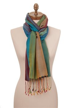 This Rainbow silk scarf is woven in all of the colours of the rainbow. This is a stunning scarf and is perfect for those who just can't pick one colour! Beautiful any time of year and with any kind of outfit, what's not to love?
