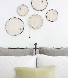 Spook guests with crocheted spiderwebs. Secure a dangling spider to the frame to complete the Halloween look.