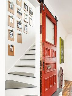 In the hallway, a cherry-colored salvaged door glides along barn door hardware, sliding open to gray-and-white-painted stairs that climb to . House Design, Remodel, Cottage Renovation, Diy Staircase, Old Cottage, Renovations, Salvaged Door, Vintage Cottage, Doors