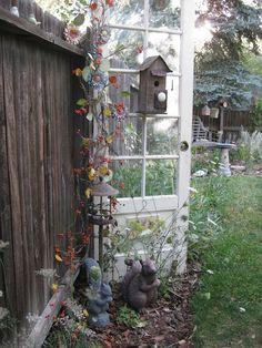 Birdhouse old door wild flowers nice Garden Whimsy, Garden Junk, Garden Doors, Lawn And Garden, Old Door Decor, Recycled Door, Vintage Garden Decor, Rustic Gardens, Old Doors