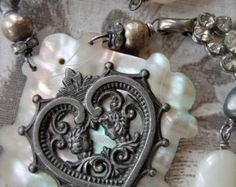 RESERVED Loves Portrait-antique vintage mother of pearl heart and double cameo assemblage necklace