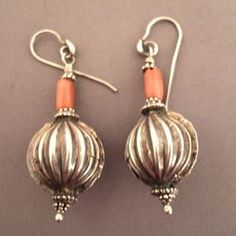"""Silver, coral, India.   Description :   This pretty pair of earrings (pumpkin design) is found in north India, combining silver and corals, the most prefered stones in these areas...  Weight:2 x 5,85gr  Height:2,165 inch  to be sale in my shop and my website www.halter-ethnic.com Under item """"Earrings"""""""
