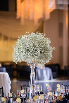 Tall baby's breath arrangements did double duty as ceremony decor and reception centerpieces.
