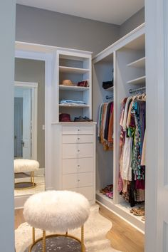 New Orleans walk in closet by Ray and Baudoin Interior Design featuring our Stud Pouf