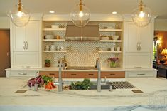 Beautiful, contemporary kitchen featuring a Galley Workstation with a Mid-Century Vibe. Design by the Kitchen Studio of Glen Ellyn. www.galleycollection.com
