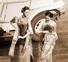 Shanghai during the Nanjing Decade. (China) #Qipao Vintage fashion style print found photo girls in Cheongsam dress fan wrap car 30s