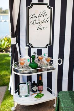"""Unique wedding décor in the form of a """"Bubble & Bauble Bar"""" on a vintage cocktail cart. Part of an """"Uptown Mod"""" wedding reception theme at Paradise Point Resort & Spa in San Diego Wedding Reception Themes, Wedding Ideas, Bubbly Bar, Event Planning Tips, Decoration, Party Time, Bubbles, Entertaining, Wedding Pins"""