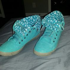 Low/high top shows These teal skull shoes can be worn either as low tops or high tops. Only worn twice!! Like new. The sides aren't dirty. That is the actual color they came as. Le Miu Shoes Sneakers