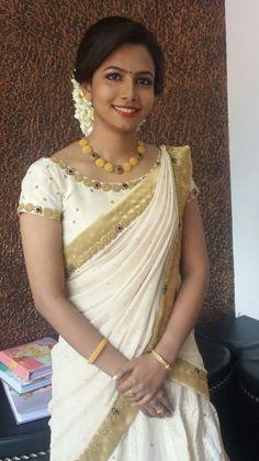 Whatsapp on 9496803123 to customise handwork Onam attire Kerala Engagement Dress, Engagement Saree, Kalamkari Blouse Designs, Blouse Designs Silk, South Indian Wedding Saree, Saree Wedding, Traditional Sarees, Traditional Outfits, Half Saree Lehenga