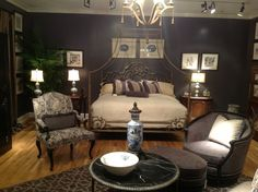 Dramatic Bedroom. Dark walls with lighter fabric/upholstery was another trend at High Point Furniture Market this Spring (2013)