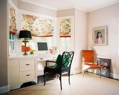 Floral roman shades above a black fretwork chair and a white built-in desk. Interior Design: Hillary Thomas