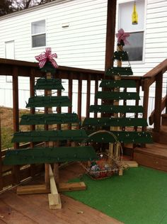 Christmas tree made out of a pallet at my friend and I made. Love them. So pretty at night.