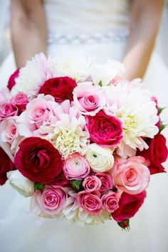 Amazing pink factor! Ranunuculs, roses (standard and spray) and white with a touch of pink football mums. Really pretty!