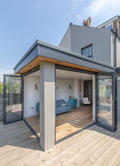 Corner opening | bi-fold doors | flat roof extension | roof overhang | level threshold | inside outside space |