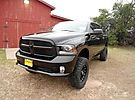 2014 Ram 1500 Express 4X4 with a 6-inch Pro Comp Lift Kit. Combine the Lift Kit with the blacked out badges and bezels of the Ram Black Express Package and you have one mean looking truck. #liftkit #liftedtrucks