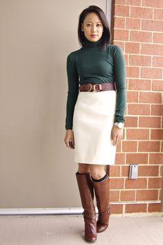green turtleneck and white skirt