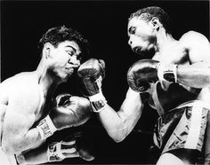 Photographer/Creator  Frank Mastro  Collection  1956  Publisher  International News Photos  Caption/Description  A stiff right uppercut, thrown by Miguel Berrios of Puerto Rico rearranges the features of Kid Anahuac during their Madison Square Garen slugfest. This kind of punching won the bout for Senor Berrios.
