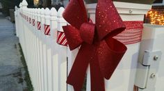 Ribbon and Bow on fence. Christmas Light Show, Christmas Windows, Christmas Bows, First Christmas, White Christmas, Christmas Holidays, Merry Christmas, Christmas Ornaments, Holiday Lights