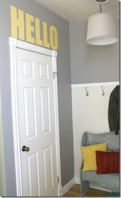 love this entry way ... that 'hello' sign is perfect!