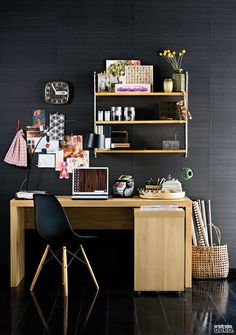 Love the wall as pinboard. Also love light and natural furnishings agains a dark and textured wall.
