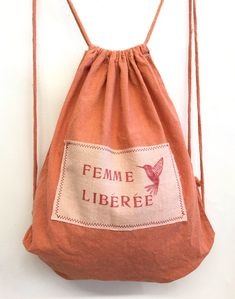 Rucksack dyed with madder, label dyed with avocado-seeds....