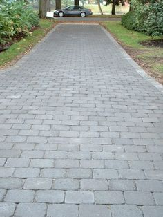 Tumbled for a time-worn appearance, Roman Cobblestone pavers add character and beauty to any outdoor space. Cobblestone Pavers, Circle Driveway, Paver Patterns, Outdoor Walkway, Stone Flooring, Outdoor Spaces, Outdoor Ideas, Walkways, Driveways