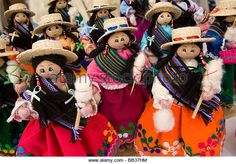 Dolls on display at market, Cuenca, Ecuador, South America - Stock Image