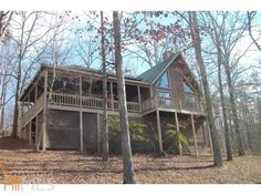 LOOKING FOR THAT REAL GETAWAY??? THIS HOME SITS BACK IN THE WOODS ON 26+/- ACRES WITH YOUR OWN PRIVATE LAKE. YOU CAN SIT ON THE FRONT PORCH SWING, ROCKING CHAIR FRONT PORCH OR KICKED BACK IN A RECLINER IN YOUR LIVING ROOM AND ENJOY THE LAKE VIEW. HOME FEATURES VAULTED CEILING WITH EXPOSED BEAMS, LOFT AREA WITH BED AND BATH WITH BUILT IN AREAS FOR EXTRA SLEEPING SPACE. OFFICE AREA AVAILABLE. MASTER BEDROOM AND BATH ARE ON THE MAIN LEVEL. THIS CABIN IN THE WOODS IS THE PERFECT PLACE TO CALL…