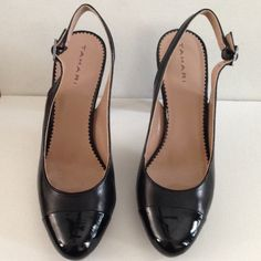 "Tahari ""Kristen"" pumps Leather with patent leather tips. In excellent shape! Small security tag puncture on inside of straps. Size 8 1/2 M Tahari Shoes Heels"