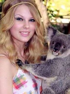 T-Swift Holds a Koala | 8 Pictures Of How Celebrities Made Holding Koalas A Thing