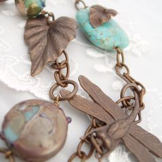 Dragonfly necklace with turquoise and flowers.