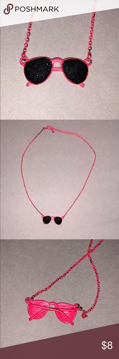 neon pink sunglasses necklace found a box full of jewelry. looks gently used and is neon pink. the glasses have black glitter Accessories Jewelry