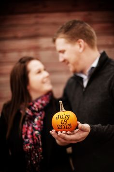 """When Cody proposed to me he put the ring in a pumpkin I was carving. I reached in to get the """"guts"""" out and there was my ring! I would love to incorporate this into our photos."""