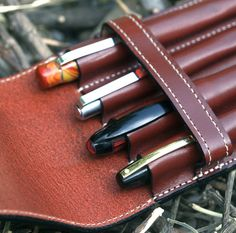 Quadruple Vegetable Tan Leather Cordovan brown pen case made with a 5 O.Z genuine cow hide leather.  Fits pens up to 6/12 inches long or 15.5