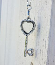 Diy Crafts Ideas : A heart shaped key glass memory locket necklace ~ holds charms and birthstones. ...  https://diypick.com/decoration/decorative-objects/crafts/diy-crafts-ideas-a-heart-shaped-key-glass-memory-locket-necklace-holds-charms-and-birthstones/