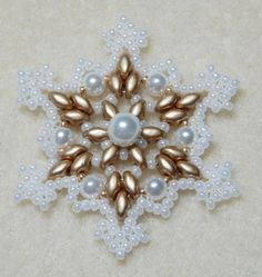 Snowflake 2 Beaded Ornament Pattern by Westtexasjewels on Etsy Snowflake Craft, Snowflake Ornaments, Christmas Snowflakes, Beaded Snowflake, Beaded Christmas Ornaments, Christmas Jewelry, Beaded Jewelry Patterns, Beading Patterns, Star Patterns