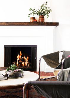 white fire place & canvas chairs